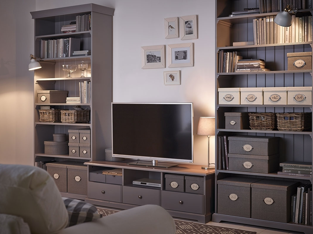 A Living Room With A White Tv Bench With Drawers And Two Grey Intended For Most Current Tv In Bookcases (View 15 of 15)