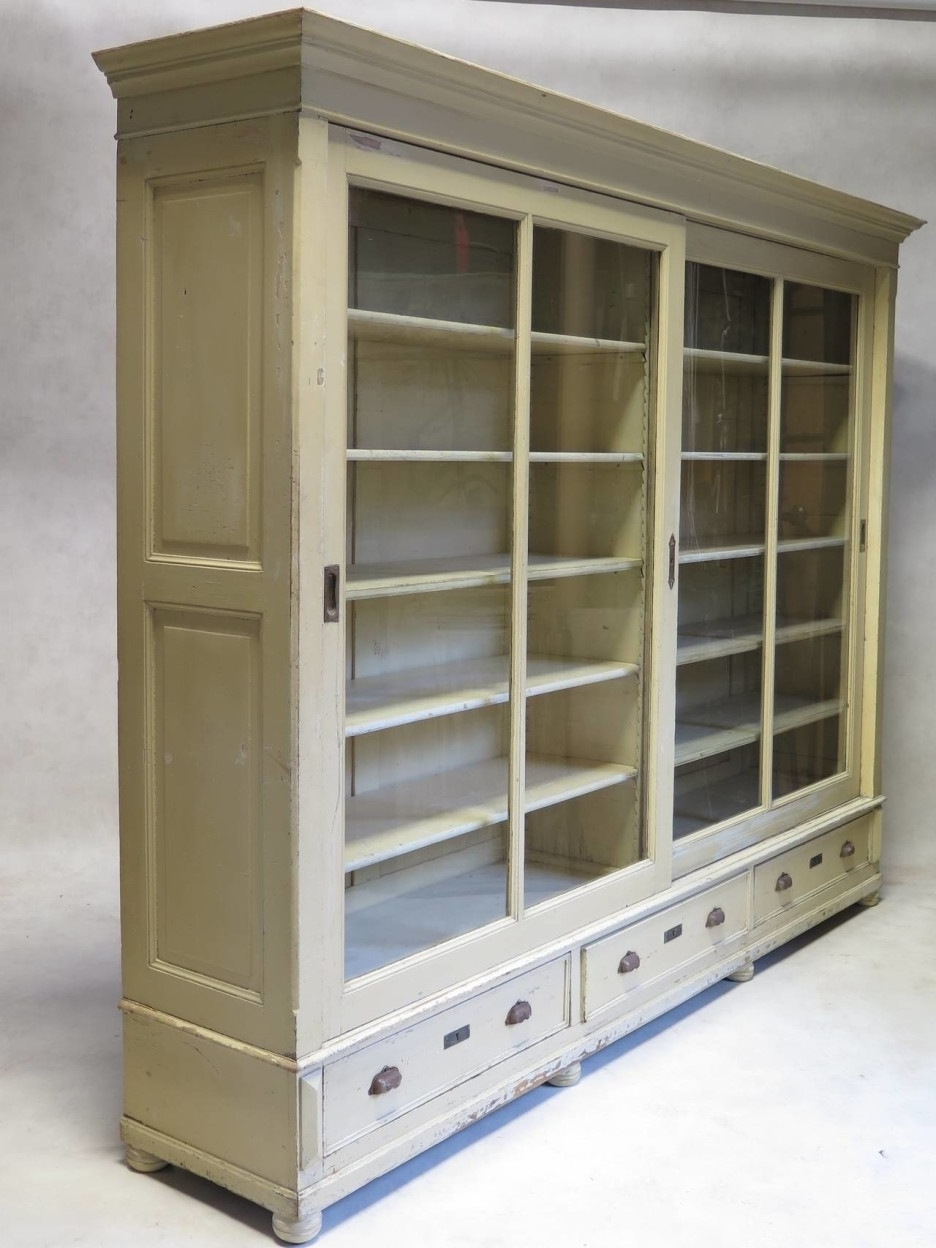 Bookcases With Drawers On Bottom Inside Latest Large Cream Wooden Bookcase With Sliding Glass Doors And Five (View 4 of 15)