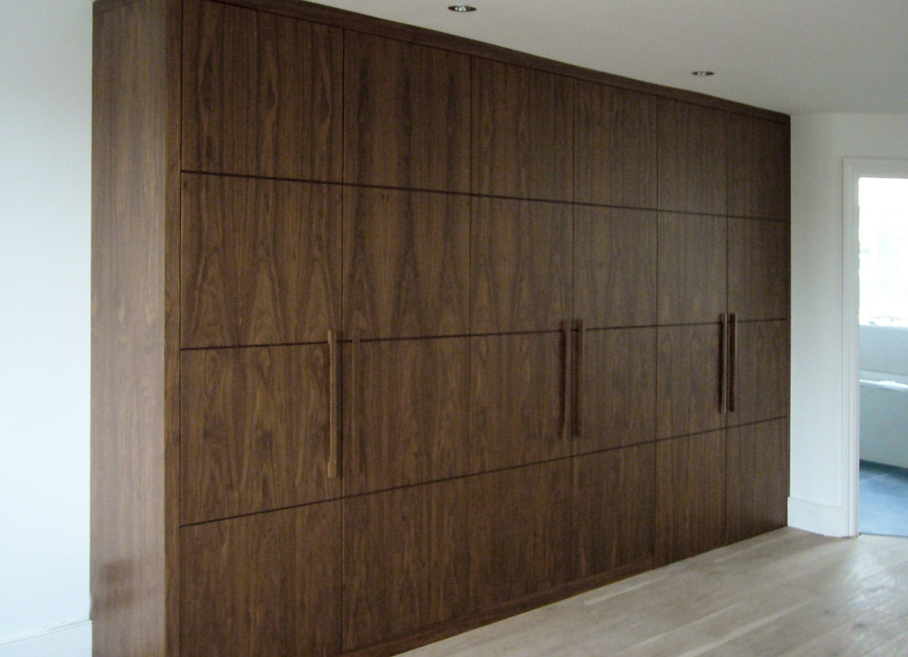 Glossy Dark Brown Closet Designs In Wooden Material With Three Within Preferred Dark Wood Wardrobes (View 14 of 15)
