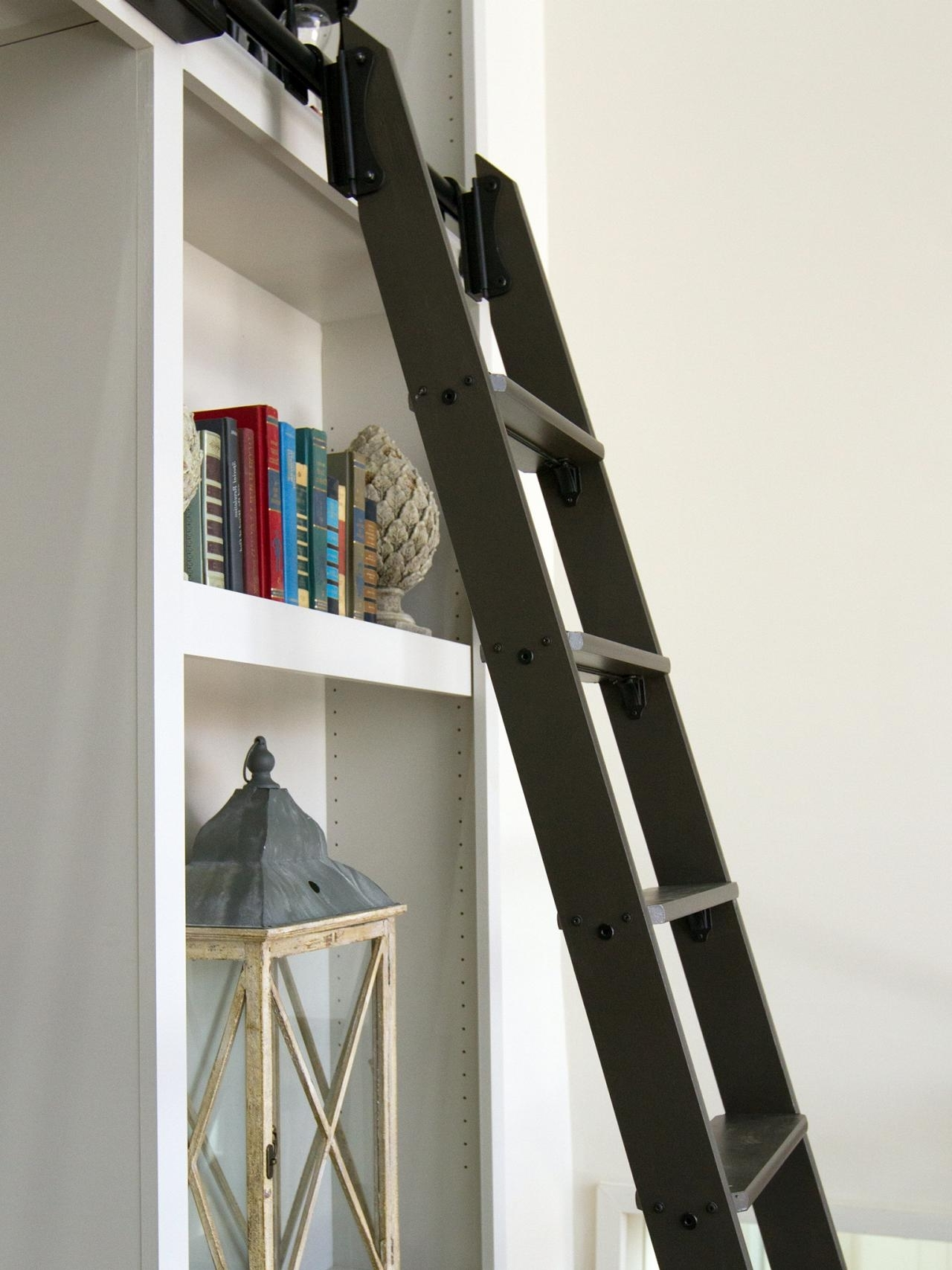 Trendy Wooden Library Ladders Regarding White Wooden Library Shelves On The White Wall With Black Wooden (View 15 of 15)