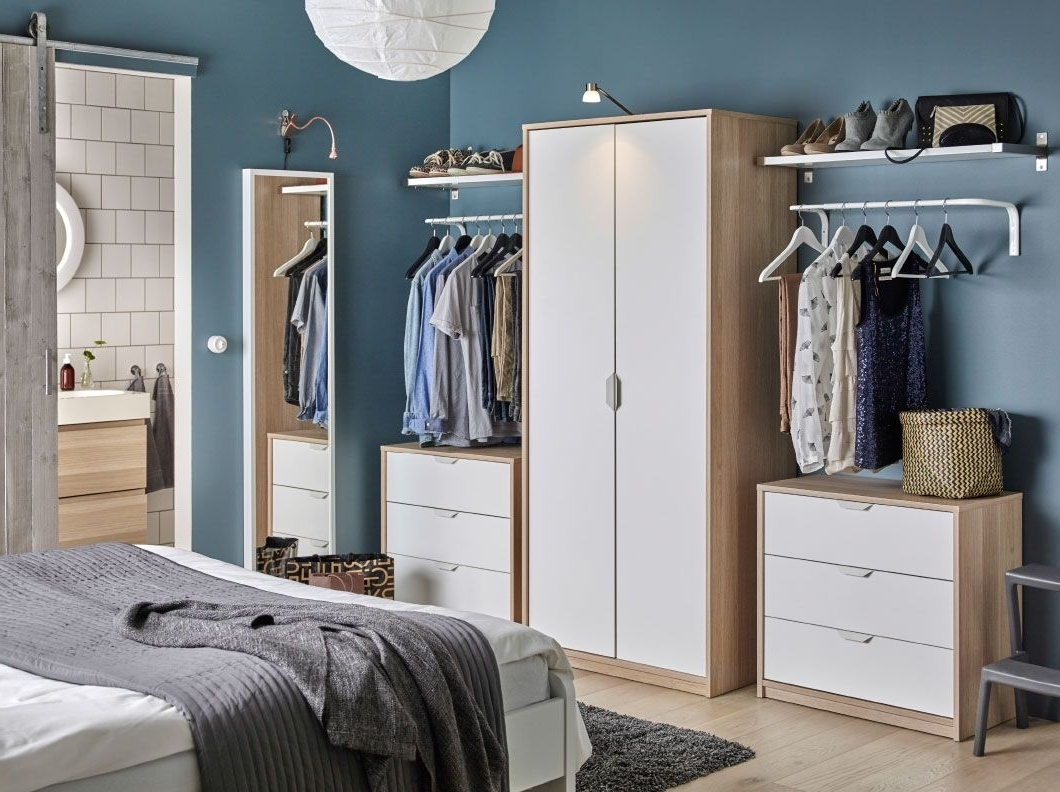 A Bedroom With A Wardrobe In Oak Effect With White Doors Combined With Recent Wardrobes Chest Of Drawers Combination (View 1 of 15)