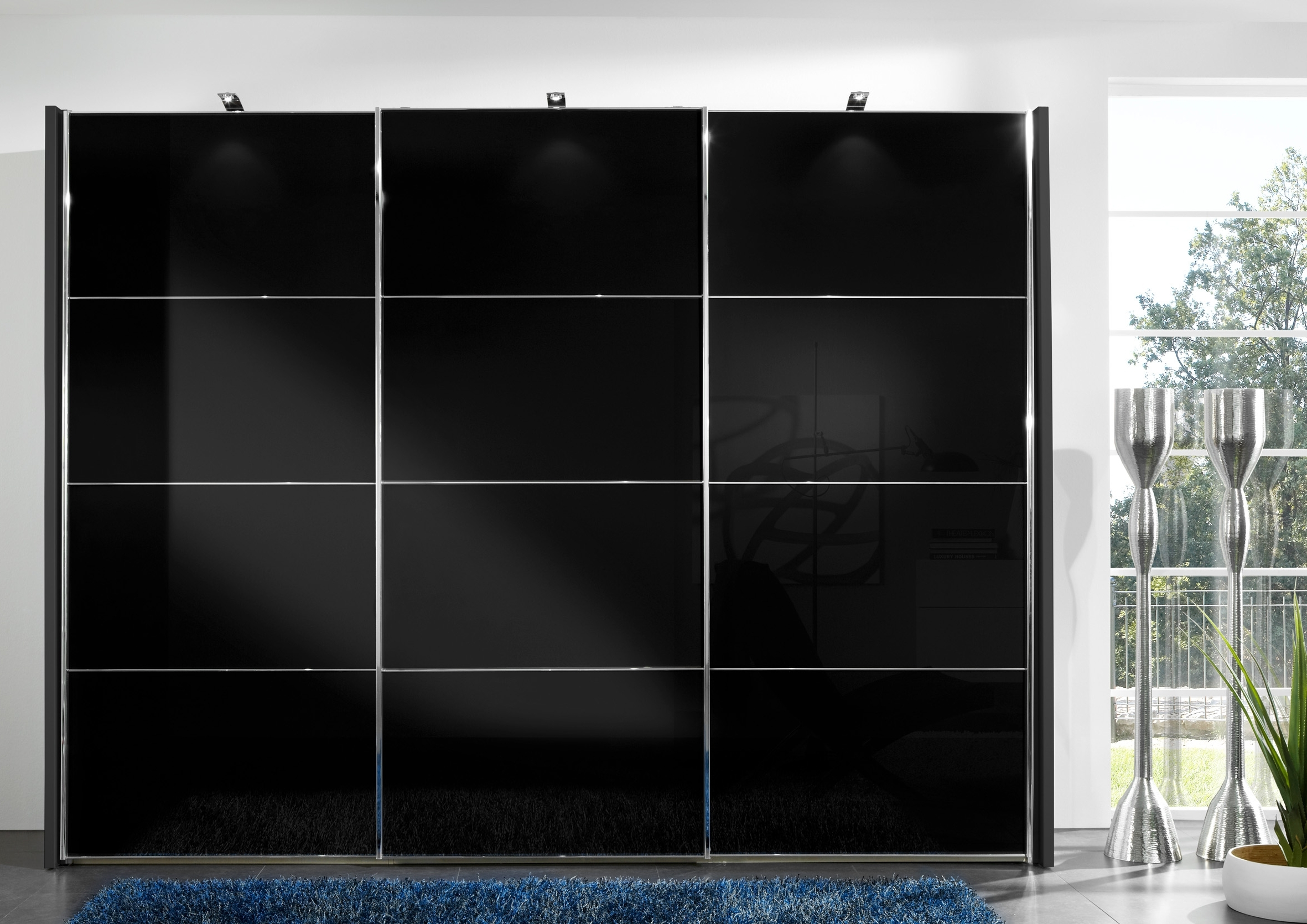 Black Sliding Wardrobes With Well Known Wiemann Miami 2 Sliding Wardrobe With Black Glass Sliding Wardrobe (View 2 of 15)