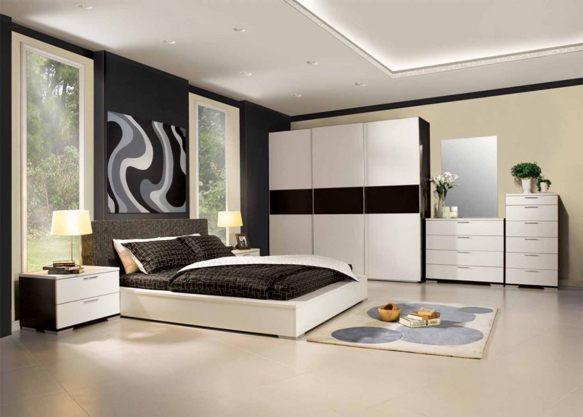 Fashionable Low Profile White Wooden Bed With White Black Bedding Set On The With Black And White Wardrobes Set (View 10 of 15)