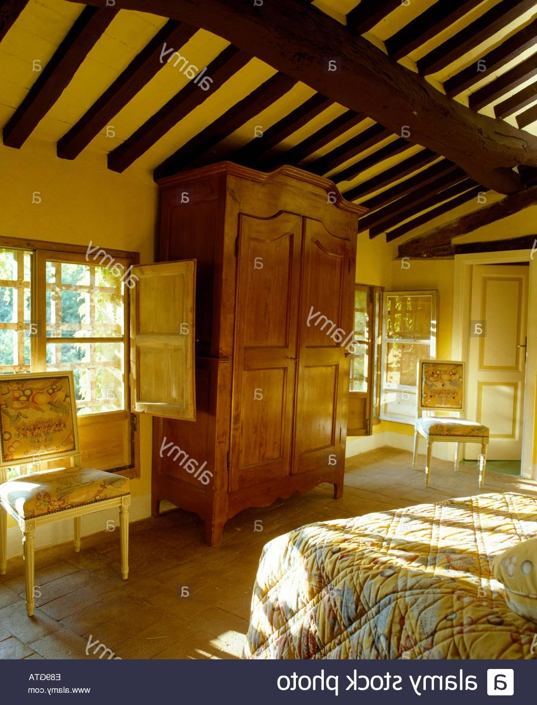 Large Antique Wardrobes In Widely Used Large Antique Wardrobe And Beamed Ceiling In Sunlit Tuscan Bedroom (View 6 of 15)