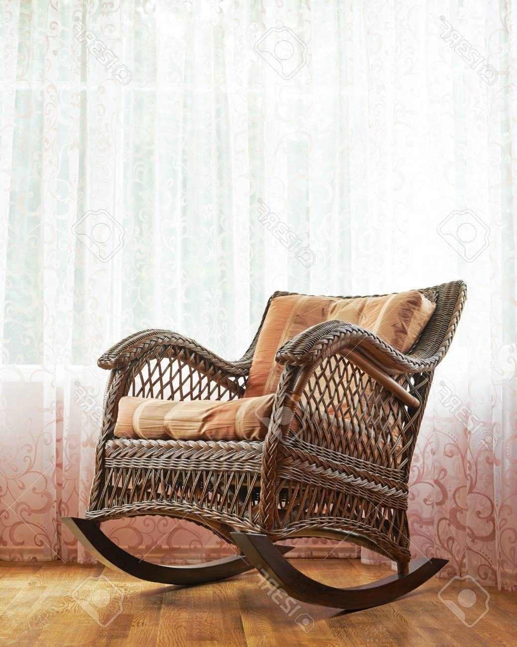 Best And Newest Indoor Wicker Rocking Chairs With Brown Wicker Rocking Chair Against The Window's Curtains, Indoor (View 2 of 15)