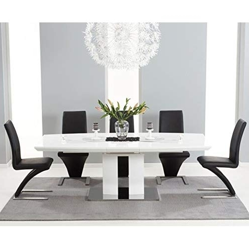 Black Extendable Dining Tables And Chairs Throughout Favorite High Gloss Dining Table And Chairs Set: Amazon.co (View 11 of 20)