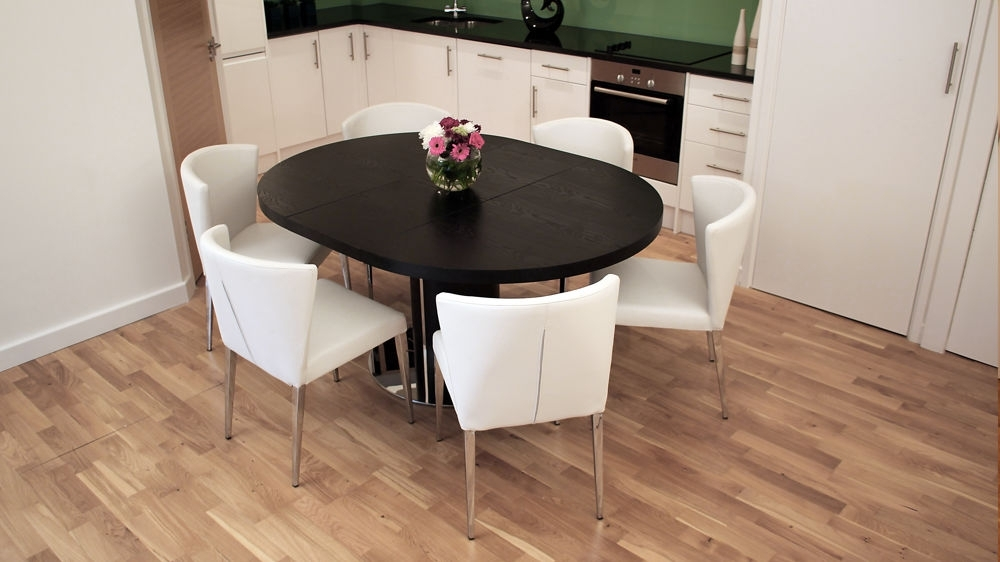 Black Extending Dining Tables Within Fashionable Black Ash Round Extending Dining Table (View 9 of 20)