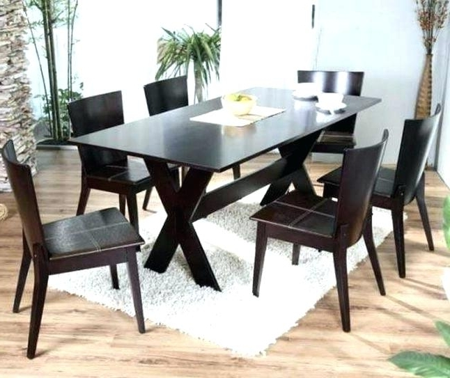 Black Wood Dining Table Dining Table On Metal Loop Legs Dark Wood For Recent Dark Solid Wood Dining Tables (View 3 of 20)
