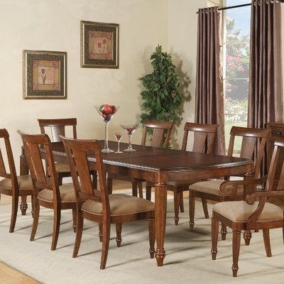 Caira 7 Piece Rectangular Dining Sets With Upholstered Side Chairs Inside Most Current Brendon 9 Piece Rectangular Dining Table Set In Hazelnut/cabernet (View 18 of 20)