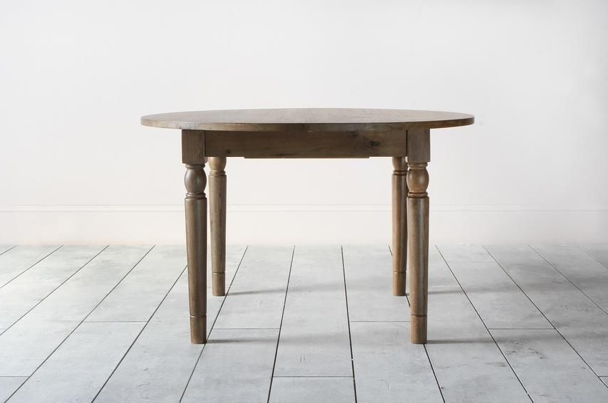 Cooper Oak Round Extendable Dining Table In Natural (View 7 of 20)