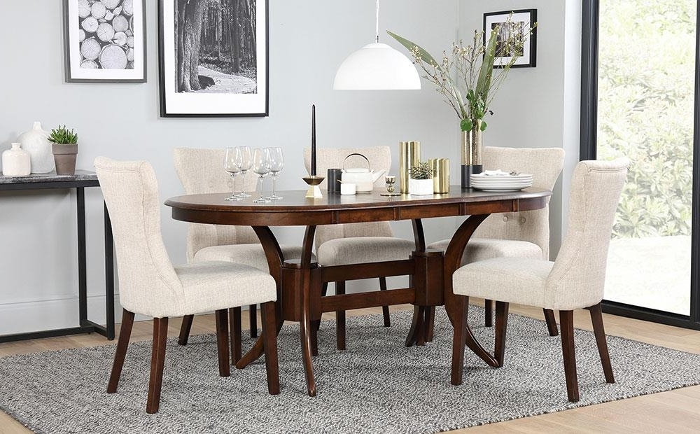 Dark Wood Extending Dining Tables With Most Current Townhouse Oval Dark Wood Extending Dining Table And 6 Chairs Set (View 7 of 20)