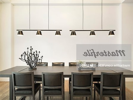 Dining Tables Lights Inside 2017 Simple Dining Table In Modern Home With Hanging Lights – Stock Photo (Gallery 12 of 20)