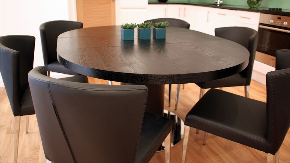 Extended Round Dining Tables With Well Liked Black Ash Round Extending Dining Table (View 10 of 20)