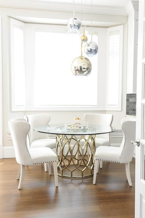 Gorgeous Dining Room Features Staggered Brass, Glass, And Chrome Inside Most Current Lassen 5 Piece Round Dining Sets (View 12 of 20)