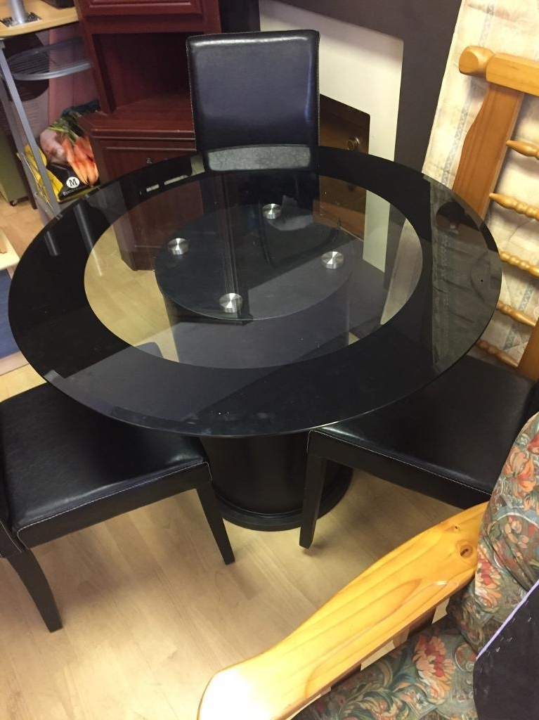 In Sunderland, Tyne Inside Current Round Black Glass Dining Tables And Chairs (Gallery 6 of 20)