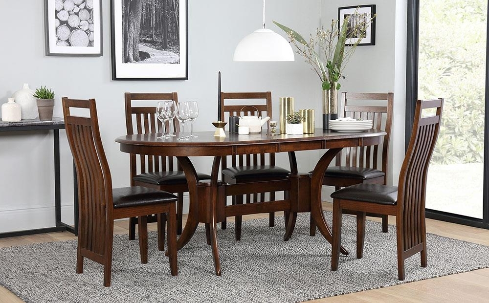 Most Popular Dark Townhouse & Java Oval Extending Dining Table And 4 6 Chairs Set In Extending Dining Tables And 6 Chairs (View 10 of 20)