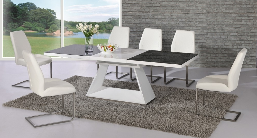 Most Recent Black Extendable Dining Tables And Chairs Intended For Amsterdam Glass And Gloss Extending White And Black Dining (View 13 of 20)