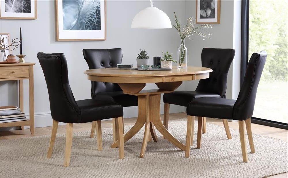 Most Recently Released Hudson Dining Tables And Chairs Regarding Hudson Round Extending Dining Table With 6 Chairs Set (Bewley Black (View 16 of 20)