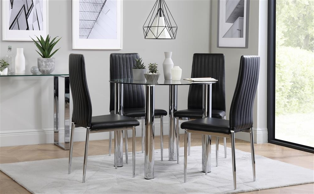 Most Up To Date Leon Dining Tables In Solar Round Chrome And Glass Dining Table With 4 Leon Black Chairs (View 16 of 20)