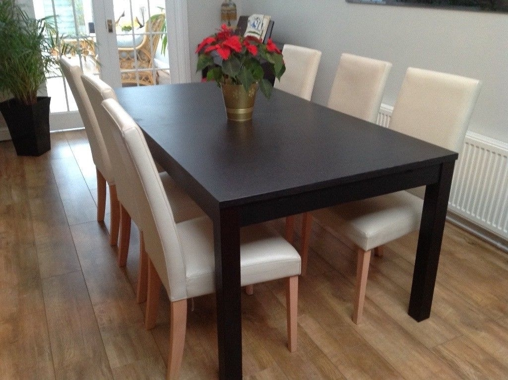 Popular Ikea Bjursta Black Extendable Dining Table & 6 Cream Chairs (View 16 of 20)