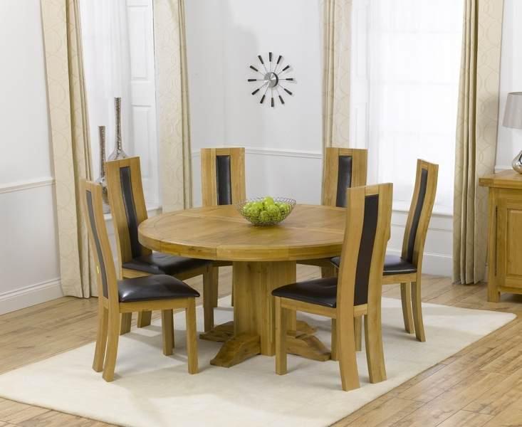 Popular Oak Round Dining Tables And Chairs Intended For Torino 150Cm Solid Oak Round Pedestal Dining Table With Toronto Chairs (View 11 of 20)