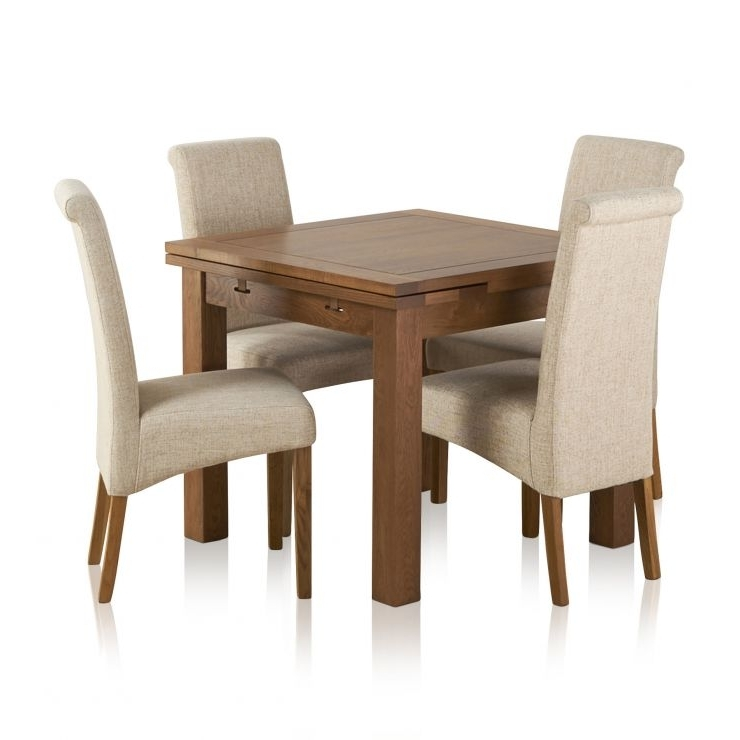 Recent Dining Extending Tables And Chairs Regarding Extending Dining Table In Rustic Oak With 4 Beige Fabric Chairs (View 20 of 20)