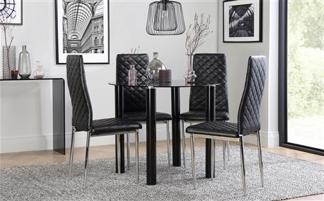 Round Black Glass Dining Tables And Chairs Inside Recent Solar Round Black Glass Dining Table With 4 Renzo Black Chairs (View 15 of 20)