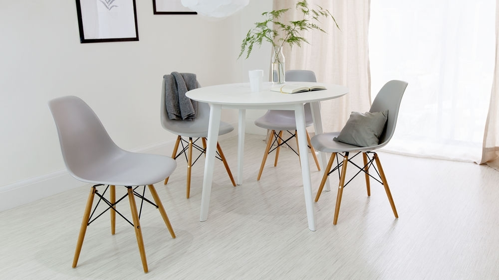 Round White Dining Table And Eames Dining Chair Set (View 11 of 20)