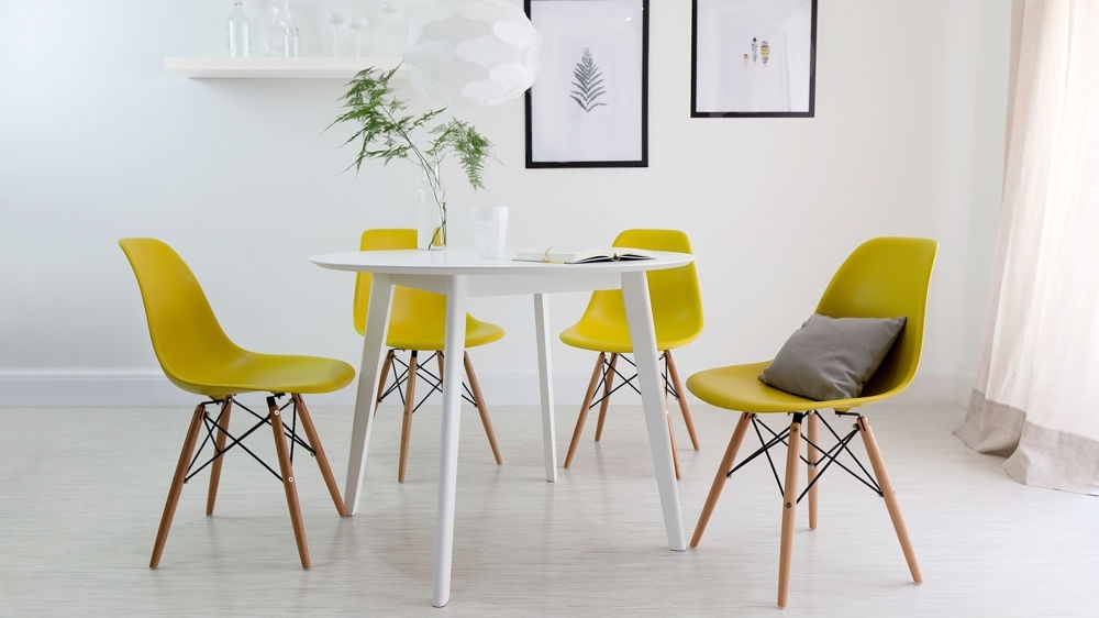 Round White Dining Table And Eames Dining Chair Set (View 12 of 20)