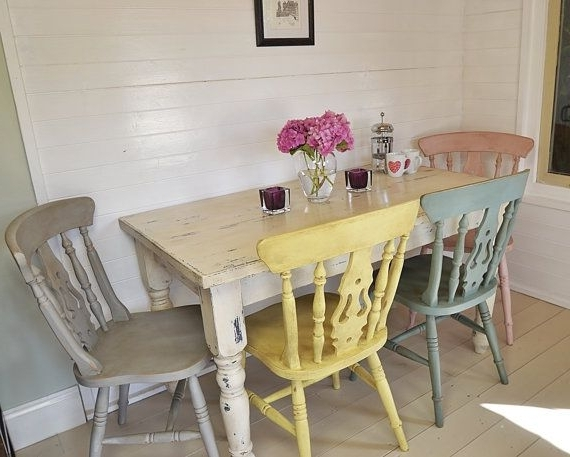 Shabby Chic Farmhouse Dining Table With Four Multicoloured Chairs Regarding Famous Shabby Chic Cream Dining Tables And Chairs (View 18 of 20)