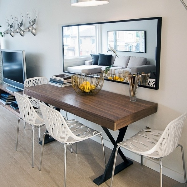Sleek Minimalist Dining Table With Mirror Wall Accent With Regard To Preferred Sleek Dining Tables (View 20 of 20)