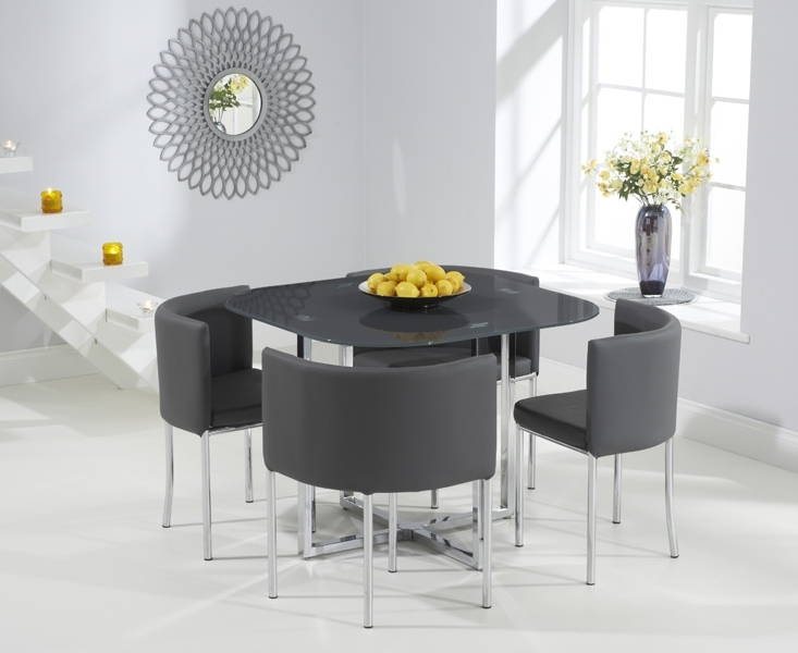 Stowaway Dining Tables And Chairs Regarding Current Algarve Grey Glass Stowaway Dining Table With Grey High Back Stools (View 17 of 20)