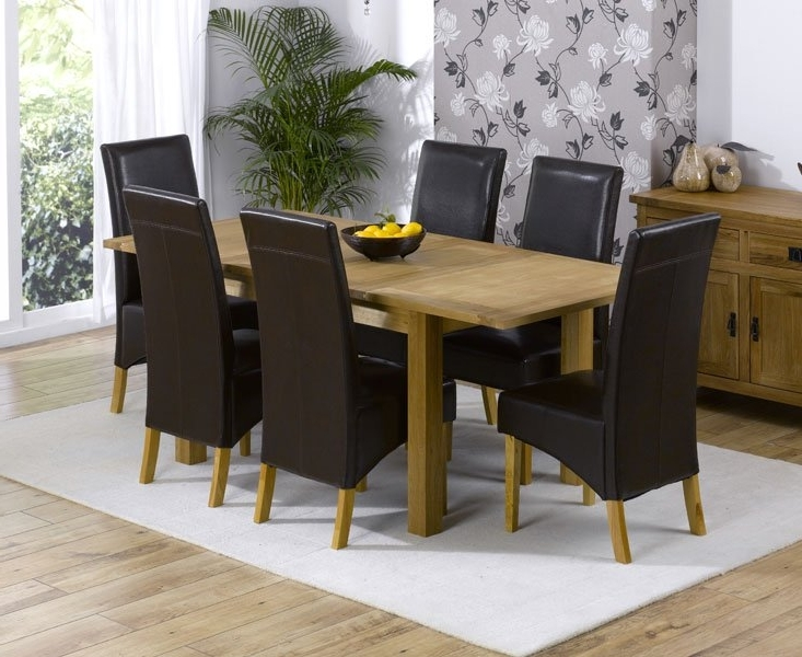 Trendy Oak Dining Tables And Chairs Throughout Cipriano Extending Oak Dining Table And 6 Leather Chairs (View 20 of 20)