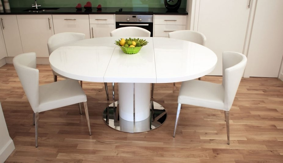 Trendy Round Dining Tables Extends To Oval Intended For Argos Set Dunelm Gumtree Chair Room Oval Round Chrome Glass Hideaway (View 16 of 20)