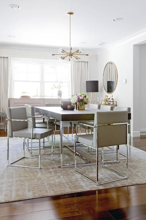 Well Liked Chrome Dining Room Chairs Intended For Contemporary Dining Room Features A Brass And Glass Sputnik (View 6 of 20)