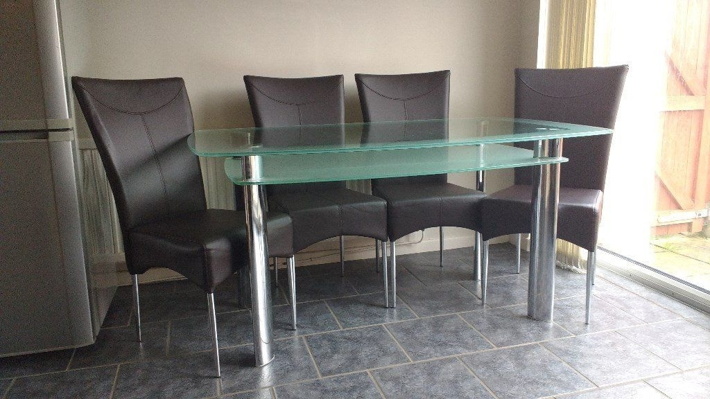 Well Liked Rectanguler Two Tiered Frosted Glass Dining Table And Four Leather Pertaining To Smoked Glass Dining Tables And Chairs (View 19 of 20)