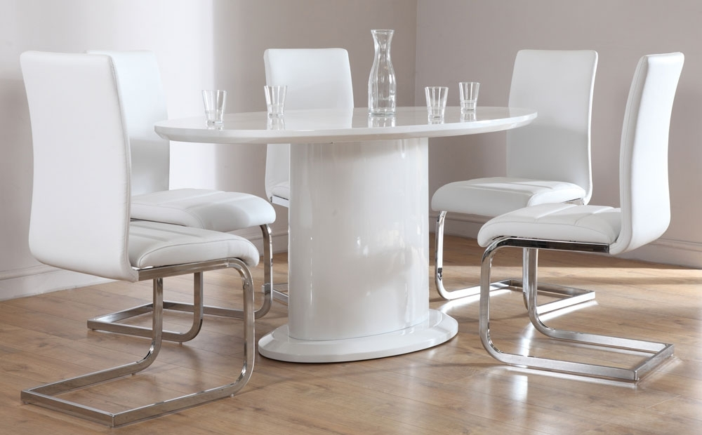 White High Gloss Dining Tables And Chairs With Regard To Widely Used Monaco White High Gloss Oval Dining Table And 4 Chairs Set (View 18 of 20)