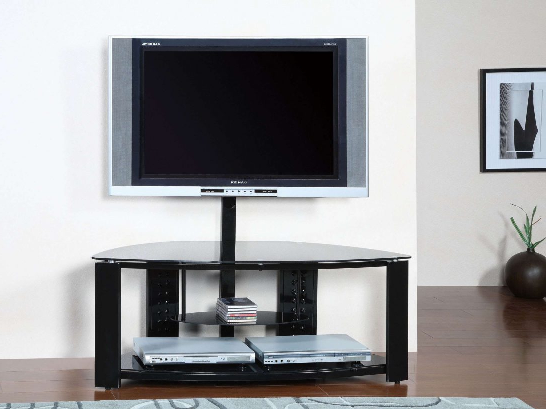 Popular Wood Tv Stands With Glass Top Intended For Universal Oval Tv Stand Walnut Effect W Black Glass Top And Shelves (View 11 of 20)
