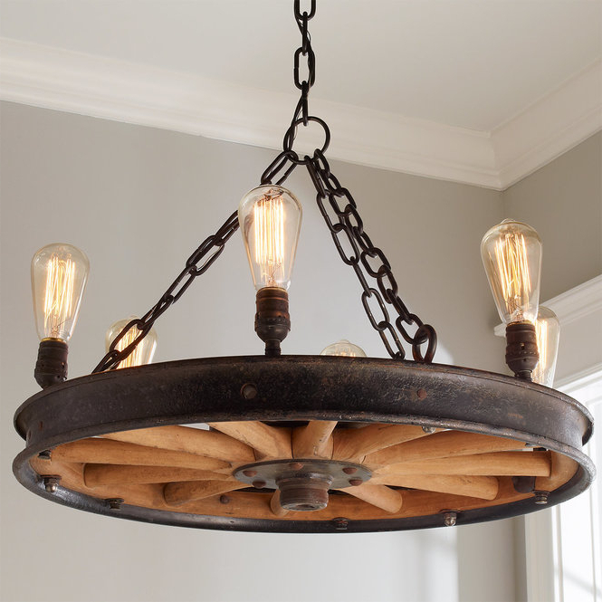 2017 Shayla 12 Light Wagon Wheel Chandeliers Intended For Wagon Wheel Chandelier Beautiful Home Decoration (Gallery 19 of 25)