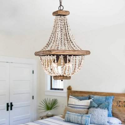 Well Liked Hatfield 3 Light Novelty Chandeliers Pertaining To Highland Dunes Stapp Aged Wood Beaded 4 Light Empire Chandelier Highland  Dunes (View 24 of 25)