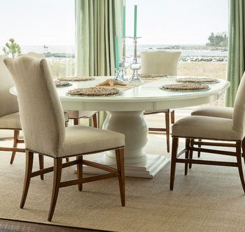 """Beautiful Coastal Home Features A 72"""" Round Pedestal Throughout Well Known Serrato Pedestal Dining Tables (View 8 of 25)"""