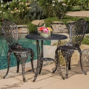 Deonte 38'' Iron Dining Tables Regarding Well Known Cole Bronze 3 Piece Aluminum Round Outdoor Bistro Set (View 9 of 25)