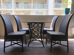 Genao 35'' Dining Tables With Regard To Fashionable Elegant Equator Outdoor Dining Table With 4 Wicker Chairs (View 14 of 25)