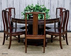Hemmer 32'' Pedestal Dining Tables In Most Popular Rosewood Dining Set Consisting Of Round Table With (View 18 of 25)