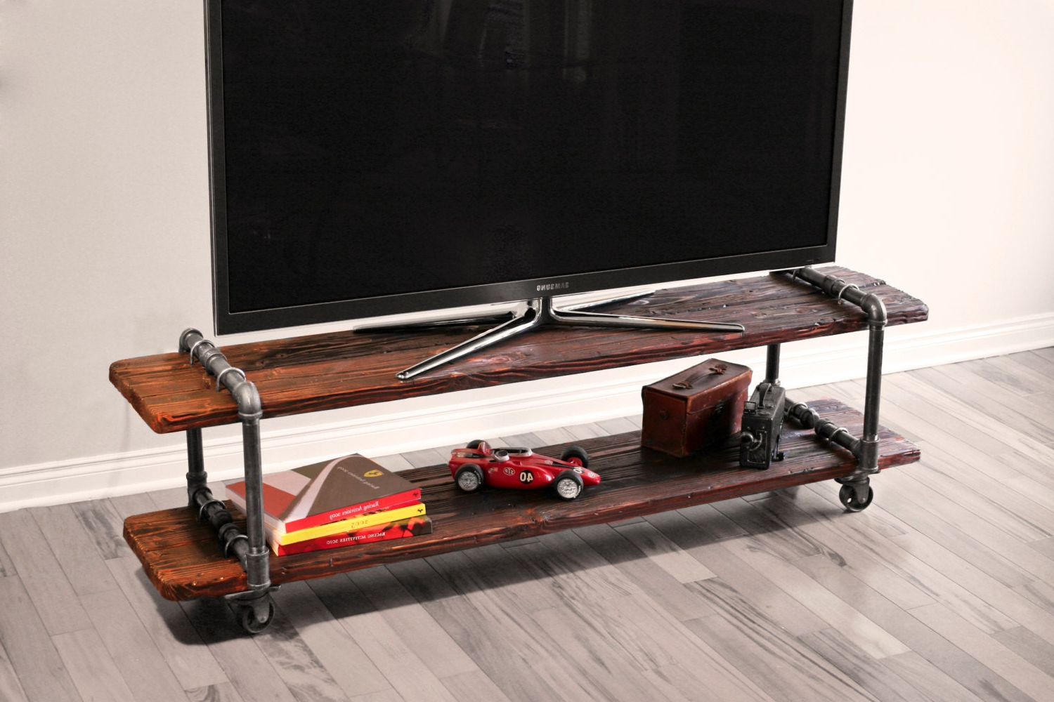 Fashionable Modern Mobile Rolling Tv Stands With Metal Shelf Black Finish With Regard To Vintage Industrial Cast Iron Pipe Table Tv Stand (View 7 of 10)