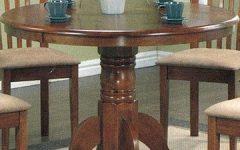 Serrato Pedestal Dining Tables