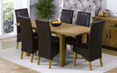 Oak Dining Tables and Leather Chairs