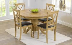 Oval Oak Dining Tables and Chairs