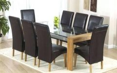 Glass Dining Tables And Leather Chairs